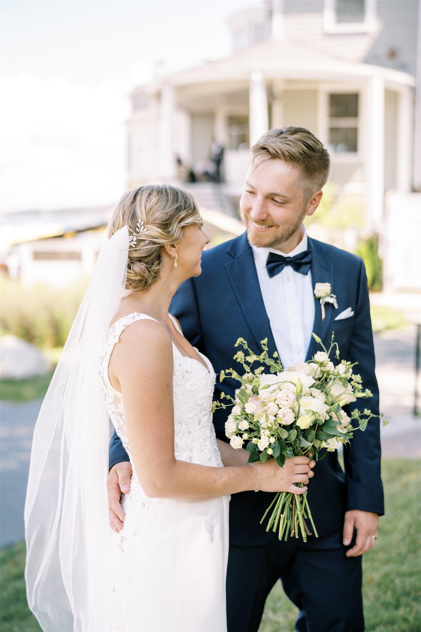 phot of bride and groom walking through the flower gardens at the Bar Harbor Inn